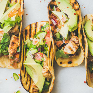 Gluten free healthy corn tortillas with grilled chicken fillet avocado lime