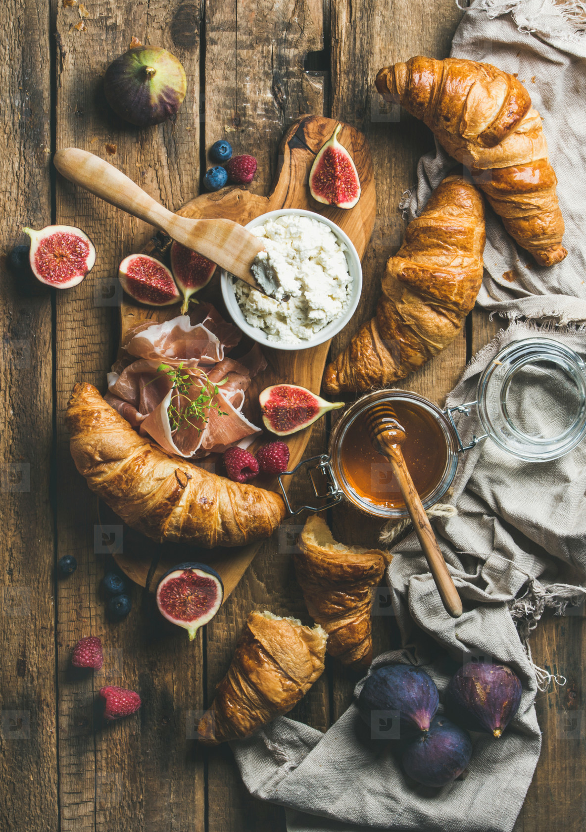 Croissants  ricotta cheese  figs  fresh berries  prosciutto and honey