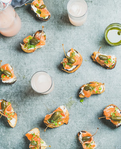 Crostini with smoked salmon and grapefruit cocktails  top view  flat lay