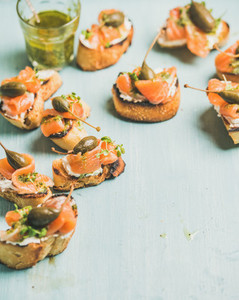 Crostini with smocked salmon pesto sauce watercress and capers