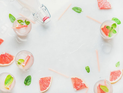 Cold refreshing alcohol cocktail with fresh grapefruit  copy space