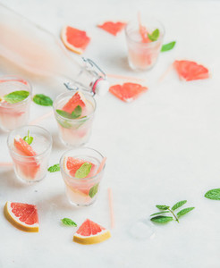 Cold refreshing alcohol cocktail with fresh grapefruit  marble background