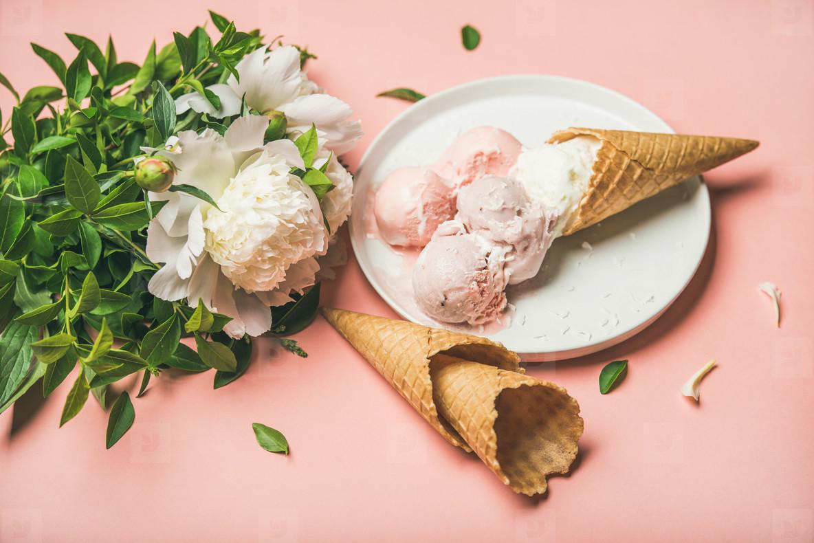 Strawberry and coconut ice cream  cones  white peony flowers