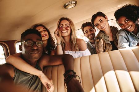 Group of friends taking selfie on road trip