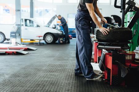 Car repair shop with mechanics working