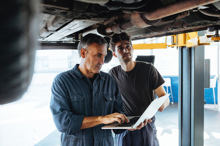 Technicians working in auto service station