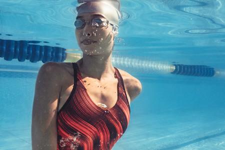 Professional swimmer inside swimming pool