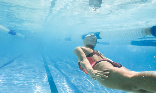 Female swimmer training in the pool