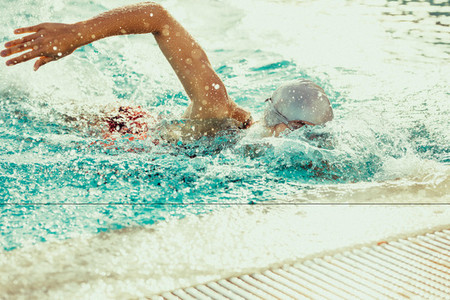 Swimmer practising for competition in pool