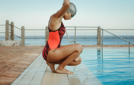 Woman getting ready for a swim