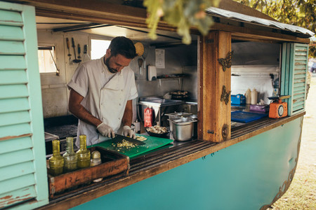 Man cooking in a mobile food truck