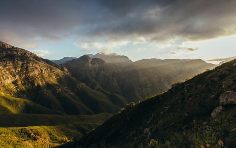 Sun rays lighting up the mountain valley
