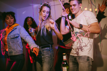 Friends dancing at a house party