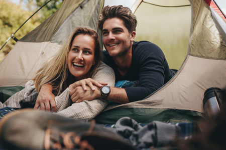 Loving couple relaxing in tent