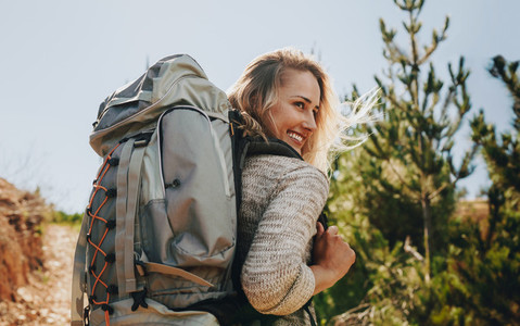Smiling woman going on a camping
