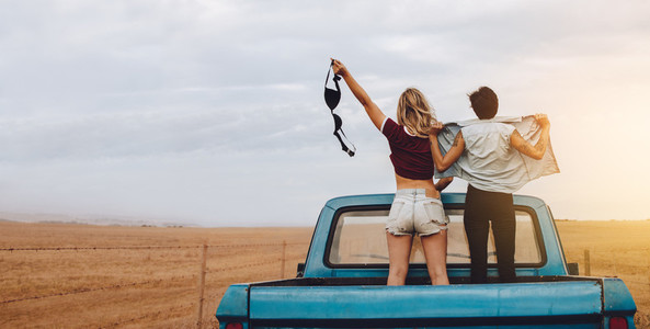 Women having fun traveling by pickup truck