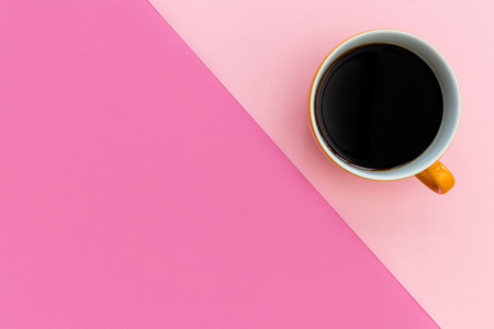 Coffee cup on minimal pink background
