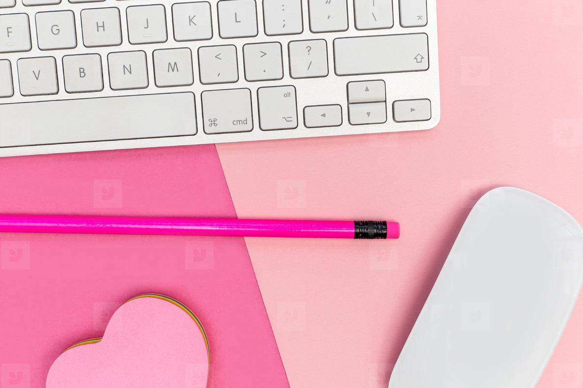 Computer keyboard on pink background minimal workspace concept