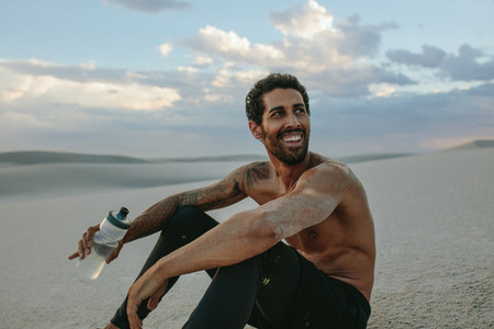 Man in desert after physical training session
