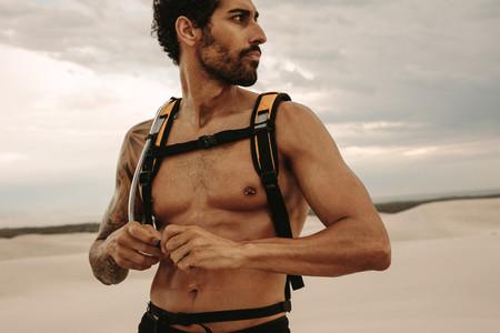 Muscular man taking break from outdoor training