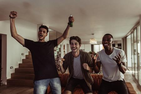 Men having fun watching television