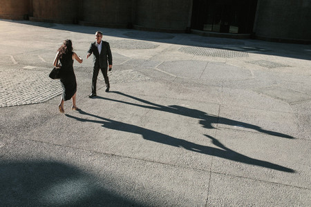 Aerial view of business colleagues meeting each other on a stree