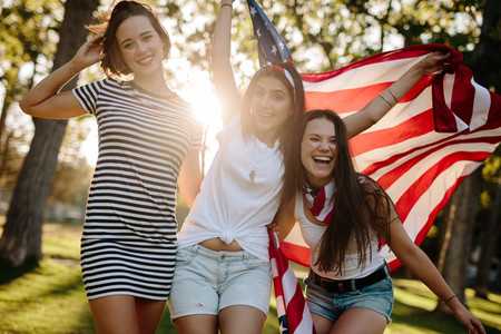 Female friends with American flag
