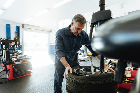 Man working in tire service workshop