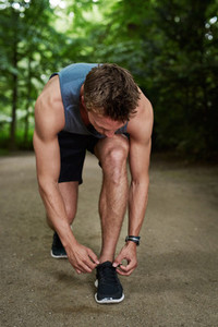 Athletic Young Man Tying his Shoelace