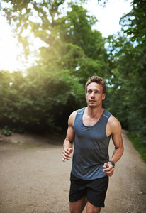 Jogger running through a wooded park