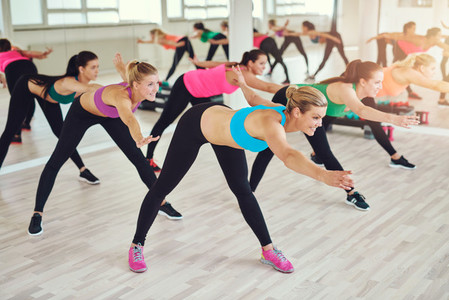 Group of fit women at a fitness class in a gym