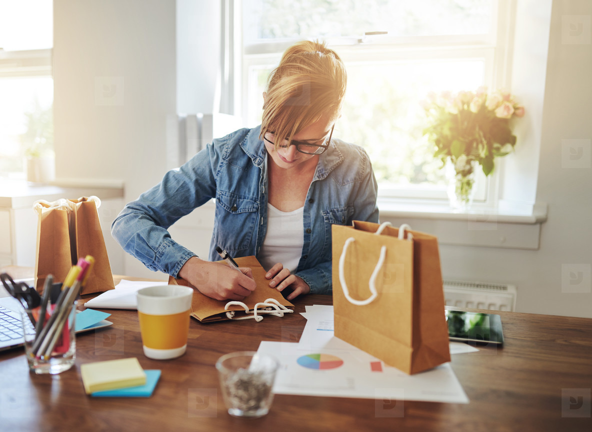 Young businesswoman designing packaging