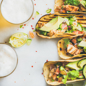 Healthy corn tortillas with chicken  vegetables  limes  square crop