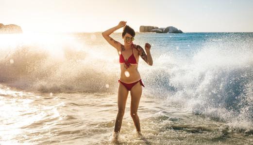 Woman enjoying sea waves at the beach