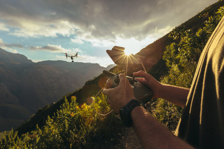 Nature photographer shooting on mountains with drone