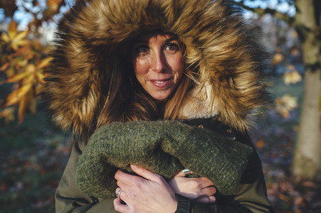 Smiling woman with hooded coat