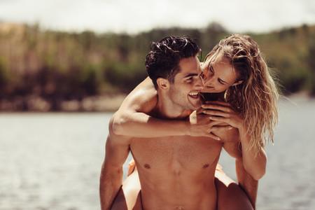 Romantic man piggybacking his girlfriend