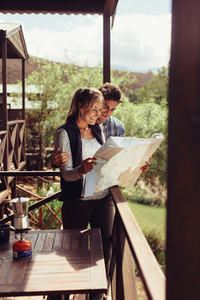 Couple looking at tourist place on map