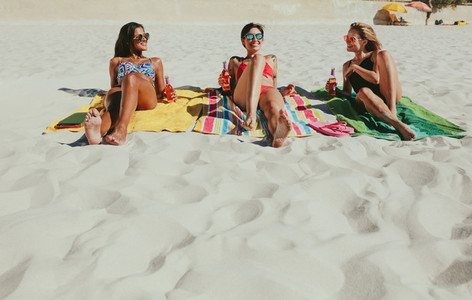 Girlfriends sunbathing on beach