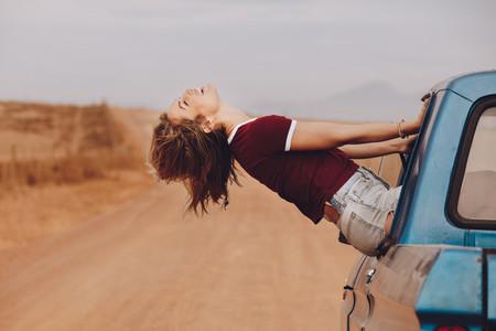 Woman enjoying the car ride