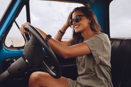 Beautiful woman driving a truck
