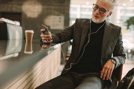 Businessman enjoying free wireless internet connection at cafe