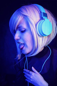 Young DJ woman at a party