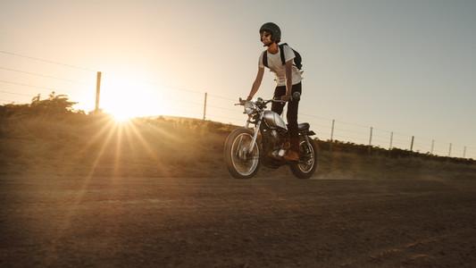 Man riding off road on vintage bike