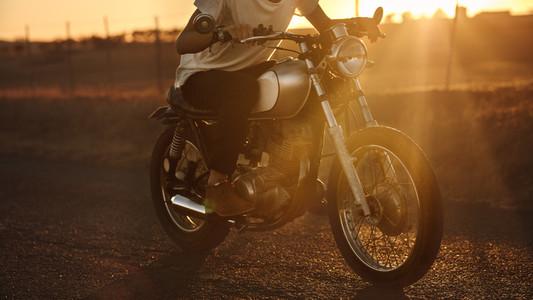 Male biker riding fast on his bike