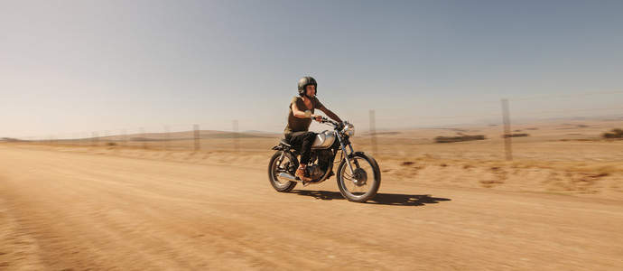 Rider driving motorcycle off road