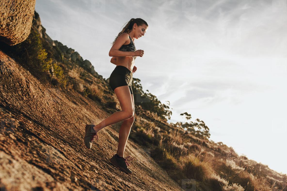 Photos - Woman trail runner training for down hill run ...