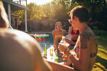 Multiracial friends enjoying at poolside party