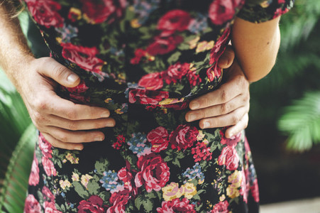 Man with hands around the waist of her girlfriend