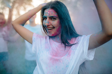 Woman enjoying festival of colors with friends